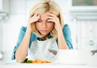 Depressed woman tired of preparing meals.