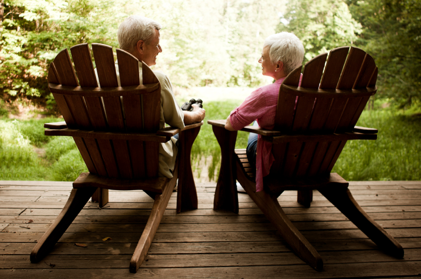 Senior Couple Lounging on a Wood Deck